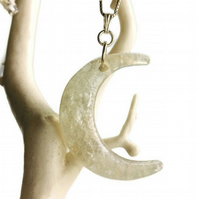 Moon pendant on sterling silver 18 inch chain.