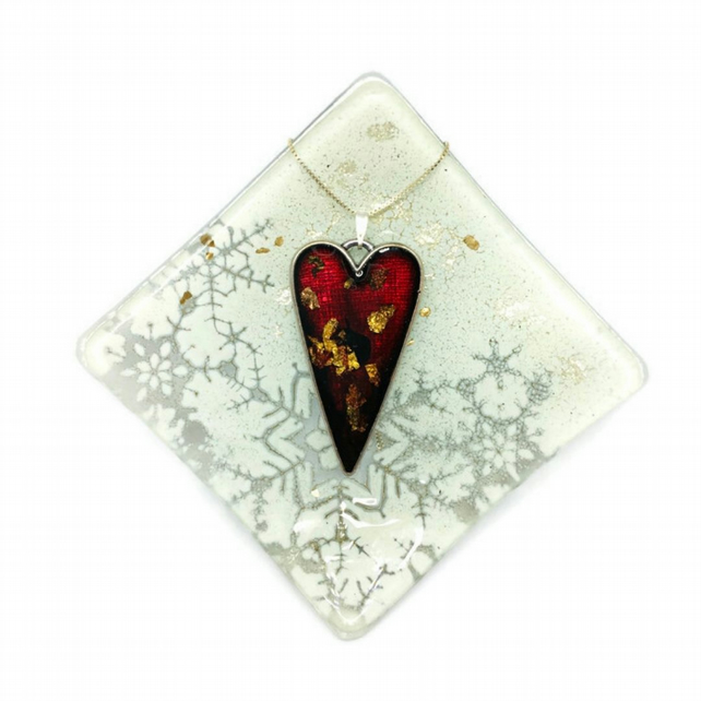 Heart necklace resin with gold and copper leaf.