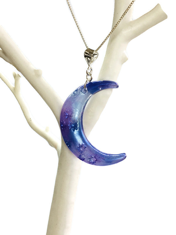 Blue and purple moon pendant and chain.