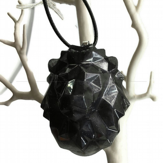 Black lion pendant with a black cord chain.
