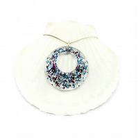 Sparkly donut necklace claret, blue and silver sparkles encased in resin.