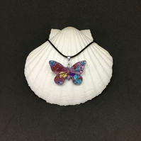 Butterfly multicoloured resin and ink necklace.