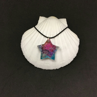 Star pink purple and blue resin and ink pendant with black cord.