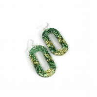 Green and gold glittery dangle earrings on sterling silver.