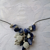 Pretty lava bead cluster necklace, black lava stones and sodalite gemstones.