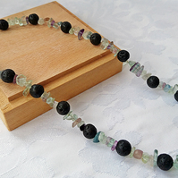 Natural lava stone necklace with rainbow fluorite chips.