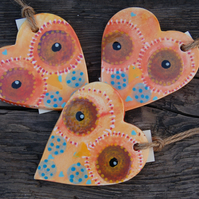 Three ceramic owl hearts