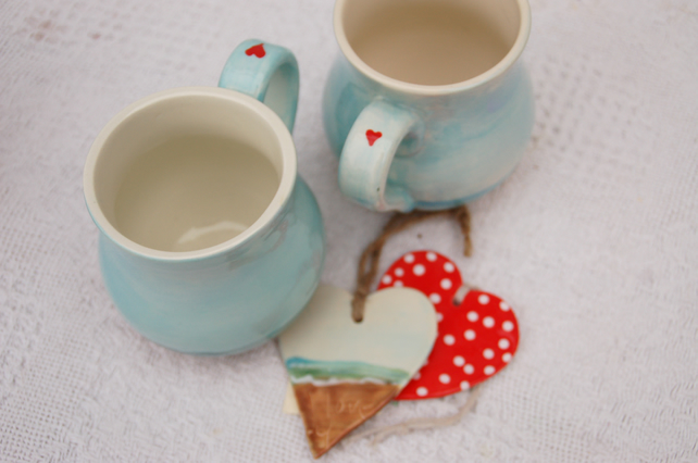 Two valentine mugs, beach