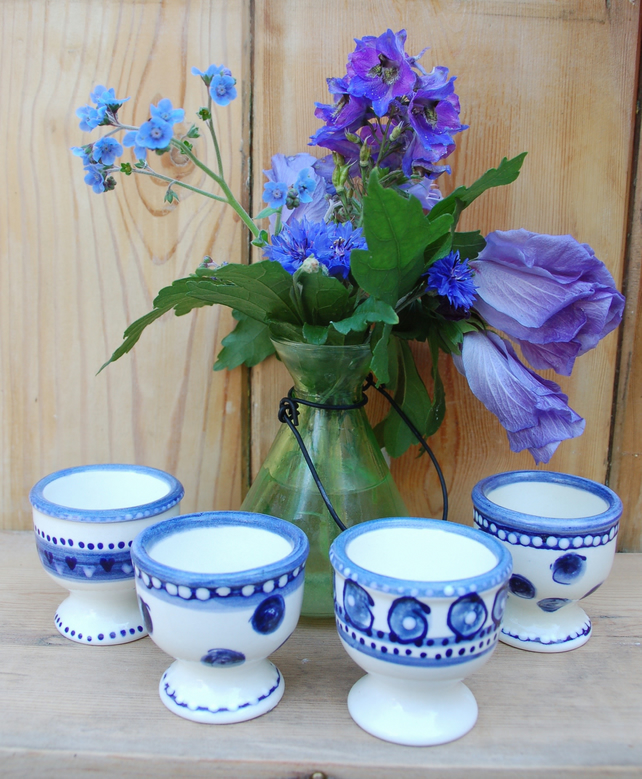 set of 4 blue and white egg cups
