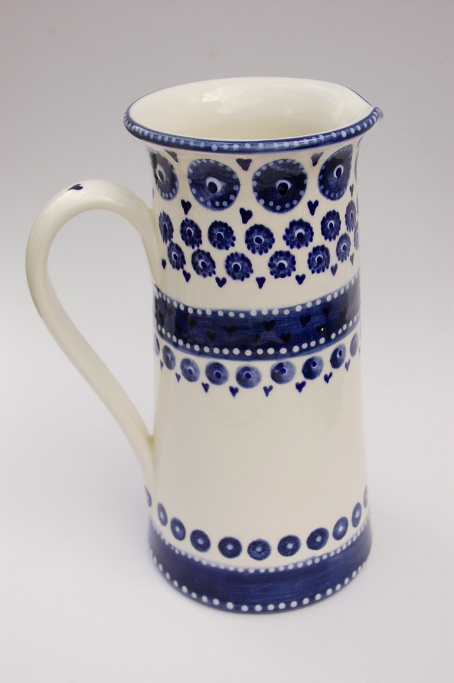 Tall blue and white hand painted jug