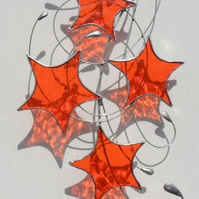 Orange Stars & Swirls Suncatcher