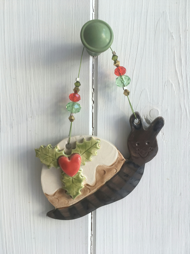 Ceramic snail Christmas pudding decoration