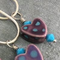 Purple heart pendant on a chain