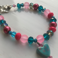 Pink & Turquoise beaded bracelet with a heart charm