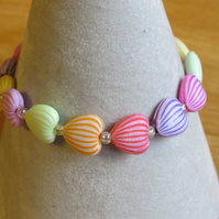 pastel coloured shell bead stretch bracelet