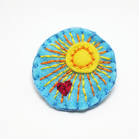 Sunburst felt pin badge