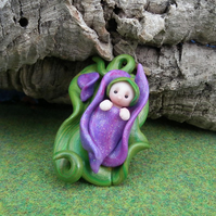 Baby Gnome on a petal crib 'Bean' OOAK Sculpt by Ann Galvin