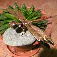 Reclaimed copper Dragonfly on a pebble.