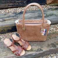 Handbag with zip top fastener in light tan real leather
