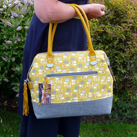Yellow & grey zip top handbag with leather handles and bag tassel