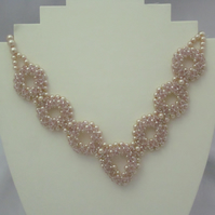 Glass pearl and pink crystal necklace