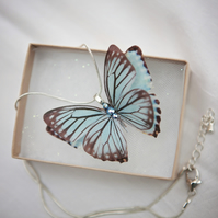 Blue silk butterfly necklace with silver plated chain and Swarovski Crystals.