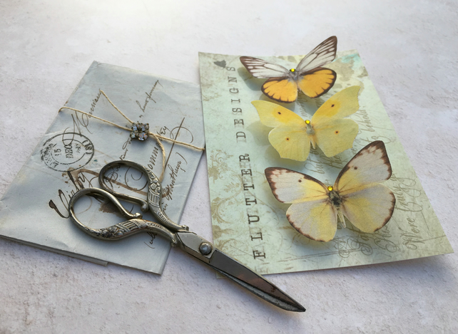 Trio of beautiful yellow silk butterfly hair clips with Swarovski Crystals.