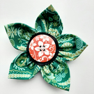 Flower brooch green (orange button)