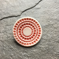 Spotty circles brooch, red glaze, white, porcelain, contemporary