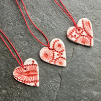Mini Folk Heart Decorations, set of three, red glaze The Porcelain Menagerie