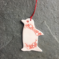 Porcelain Penguin, hanging decoration, red white spotty, The Porcelain Menagerie
