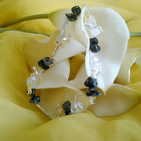 rock crystal, snowflake obsidian and melted silver elasticated bracelet