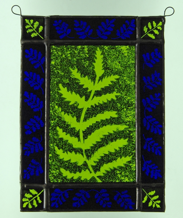 Fern silhouette suncatcher with deep blue border