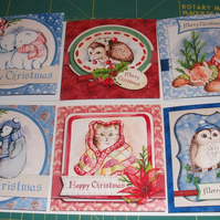 Set of 6 Christmas card with cute cosy up at Christmas animal designs.