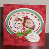 Hedgehog decoupage Christmas card with hand cut decoration and glitter