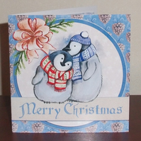 Christmas card with cute penguins in hats and scarves