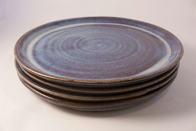 Made to order set of 8 large dinner plates. Glazed in blue beige.