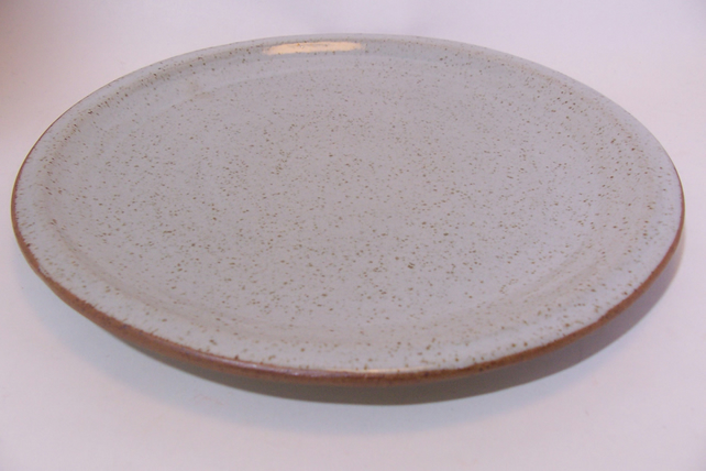 hand thrown dinner plate with raised side