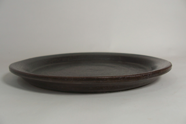 Side plate. With bronze glaze. 19 cm.