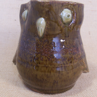 Stoneware bird jug with speckled brown glaze.