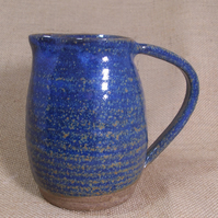Stoneware jug with deep blue glaze.