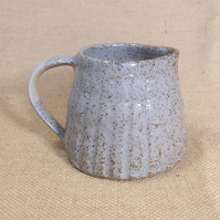 Stoneware fluted jug with white grey glaze.