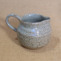Stoneware  jug with white grey glaze.
