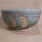 Tea bowl, (chawan). With poured celadon and blue beige glaze..