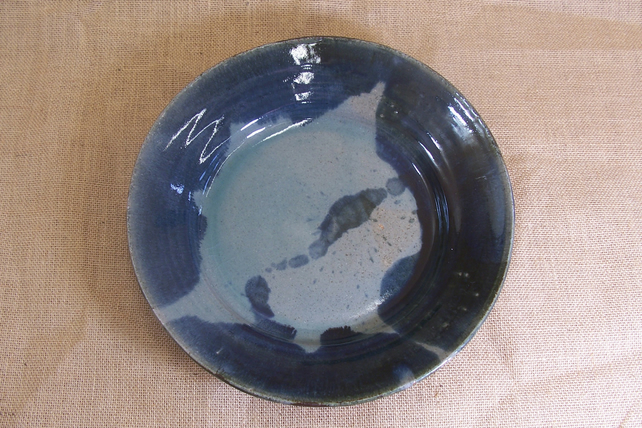 Large serving platter with poured glazes.