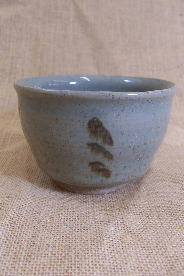 Tea bowl with celadon glaze decorated with oxide and impressed..