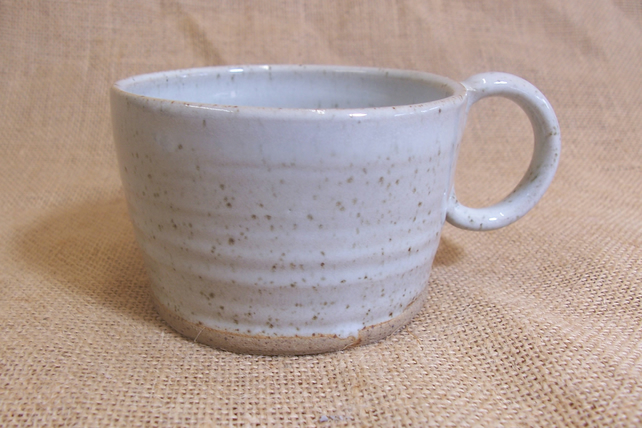 Small coffee cups, glazed in speckled white.