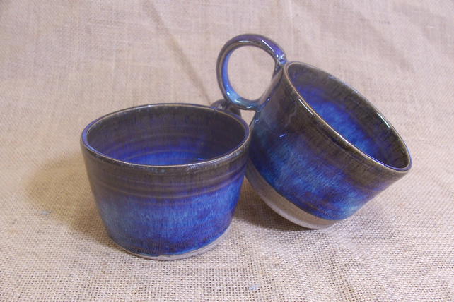 Small coffee cups, glazed in blue beige.