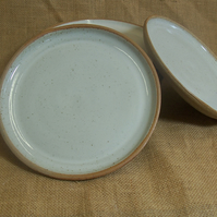 Hand thrown side plate. Glazed in speckled white. 19 cm.