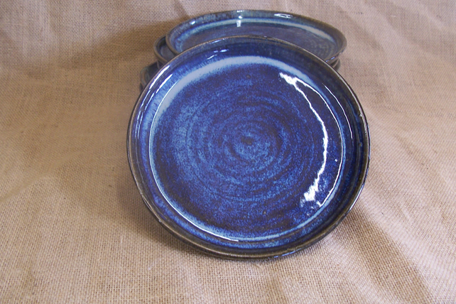 Hand thrown side plate. Glazed in blue beige. 19 cm.